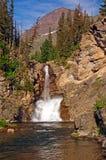 Running Eagle falls in Montana. Dramatic Running Eagle Falls in Glacier National park in Montana Stock Photo