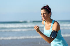 Running with earphones and sport band Royalty Free Stock Photo