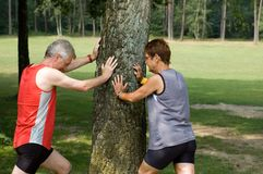 Running exercise. Active seniors doing their running exercises royalty free stock images