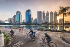 Running an exercise bike parks in the city. Royalty Free Stock Images