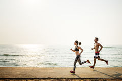 Running Exercise Training Healthy Lifestyle Beach Concept Royalty Free Stock Photography