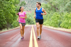 Running - exercising couple jogging Royalty Free Stock Photos