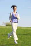 running för konditionflickapark Royaltyfri Bild
