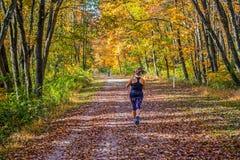 Running Through Fall Park Stock Photography