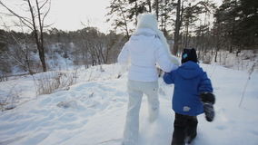 Running and falling into snow. stock footage