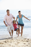 Running Family On Beach Holiday Stock Images