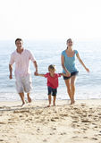 Running Family On Beach Holiday Royalty Free Stock Photography
