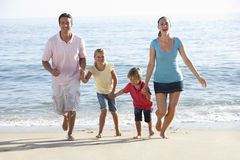 Running Family On Beach Holiday Royalty Free Stock Images