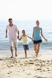 Running Family On Beach Holiday Royalty Free Stock Photo