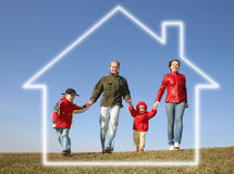 Running family in dream house stock photo