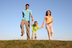 Running family on meadow 2 Stock Images