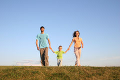 Running family on meadow 3 Stock Photo