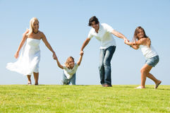 Running Family On Meadow Stock Images