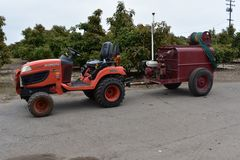 An orchard tractor with an orchard air fan sprayer attached, 1. stock photo