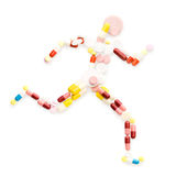 Running fast. Creative medicine and healthcare concept, doping drugs and pills in the shape of an athletic runner on track Stock Photos