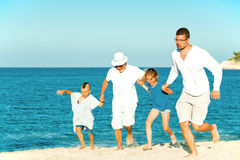 Running father grandfather kids beach run Stock Image