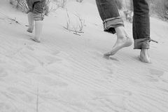 Running father and kid - toes in sand. Legs of running father and kid - toes in sand Royalty Free Stock Images