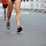 Running feet. Of marathon racers Royalty Free Stock Photo