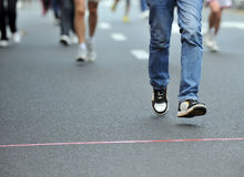 Running feet. Of marathon racers Royalty Free Stock Image