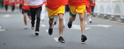 Running feet. Of marathon racers Stock Photography