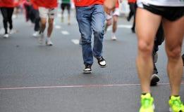 Running feet. Of marathon racers Royalty Free Stock Images