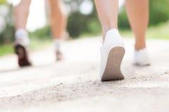 Running feet. Close-up of legs running outdoors Stock Photo