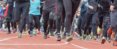 Running feet and legs in the Tough Viking Event Royalty Free Stock Photography