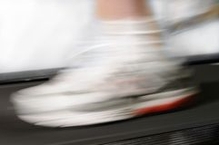 Running feet with motion blur Royalty Free Stock Photography
