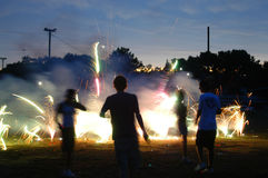 Running into Fireworks. A bunch of teens running around fireworks Royalty Free Stock Images