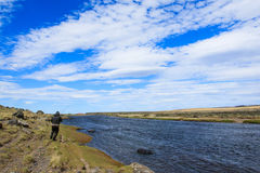 Running for fish. Lucky flyfisherman running for big seatrout, Rio Gallegos, Argentina Royalty Free Stock Photo