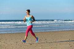 Running for fitness on beach Stock Photo