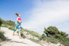 Running fitness girl in outdoors. Sporty slim woman Royalty Free Stock Photo