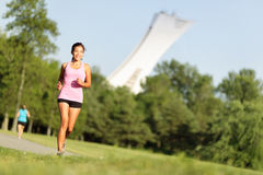 Running fitness in summer city park Royalty Free Stock Images
