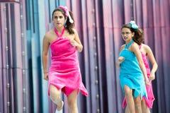 Running Flintstone girl Royalty Free Stock Photos