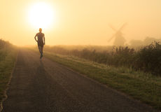 Running in the fog Royalty Free Stock Images