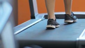 Running foot on a treadmill. 4K Running foot on an indoor track stock video