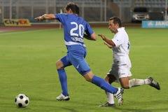 running fotboll för fotbollsspelare Royaltyfria Bilder