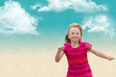 Running free. A joyful little girl running free against a textured cloudy sky background Royalty Free Stock Photos
