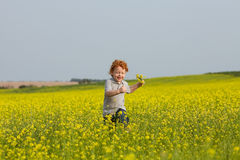 Running ginger boy Royalty Free Stock Photos