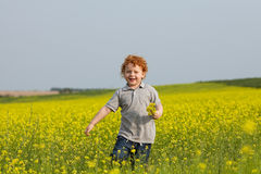 Running ginger boy Royalty Free Stock Photography