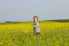 Running ginger boy Stock Photo