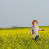 Running ginger boy Stock Image