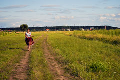 Running girl. She is run to You! This happy girl is run cross the field Stock Photography