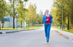 Running girl. In autumn park Stock Photography