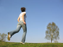 Running girl. Spring Stock Image
