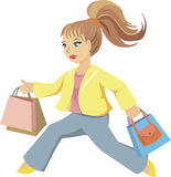 Running girl with bags. Girl with bags running for shopping Stock Photography