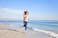 Running girl at the beach. Stock Photography