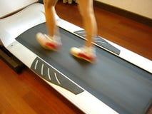 Running girl on the body builder,diagonal,feet blurred. Running girl on the body builder for fitness Royalty Free Stock Photos