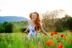 Running girl in field Stock Photography