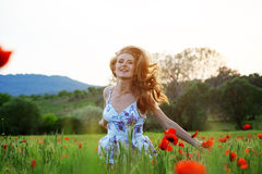 Running girl in field Stock Photos